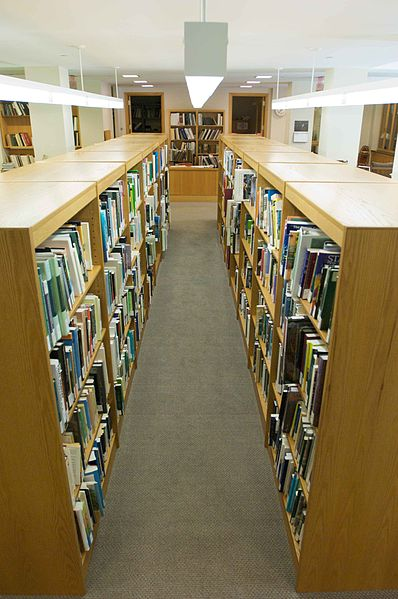 398px-Bookshelves_with_books_in_library